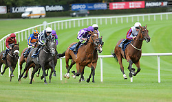 Horse Laurens & Daniel Tudhope (right) turn into the home straight to win the Group 1 Coolmore Fastnet Rock Matron Stakes from Alpha Centauri & Colm O'Donoghue (left) during day one of the 2018 Longines Irish Champions Weekend at Leopardstown Racecourse, Dublin.