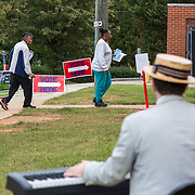 """A musician plays """"electoral themed music"""" at a polling place in Mecklenburg county on the 2016 election day in Mecklenburg county."""