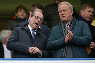 BBC political broadcaster Nick Robinson(l) talking to a friend in the stands before k/o.  Barclays Premier league match, Chelsea v Manchester Utd at Stamford Bridge in London on Sunday 7th February 2016.<br /> pic by John Patrick Fletcher, Andrew Orchard sports photography.