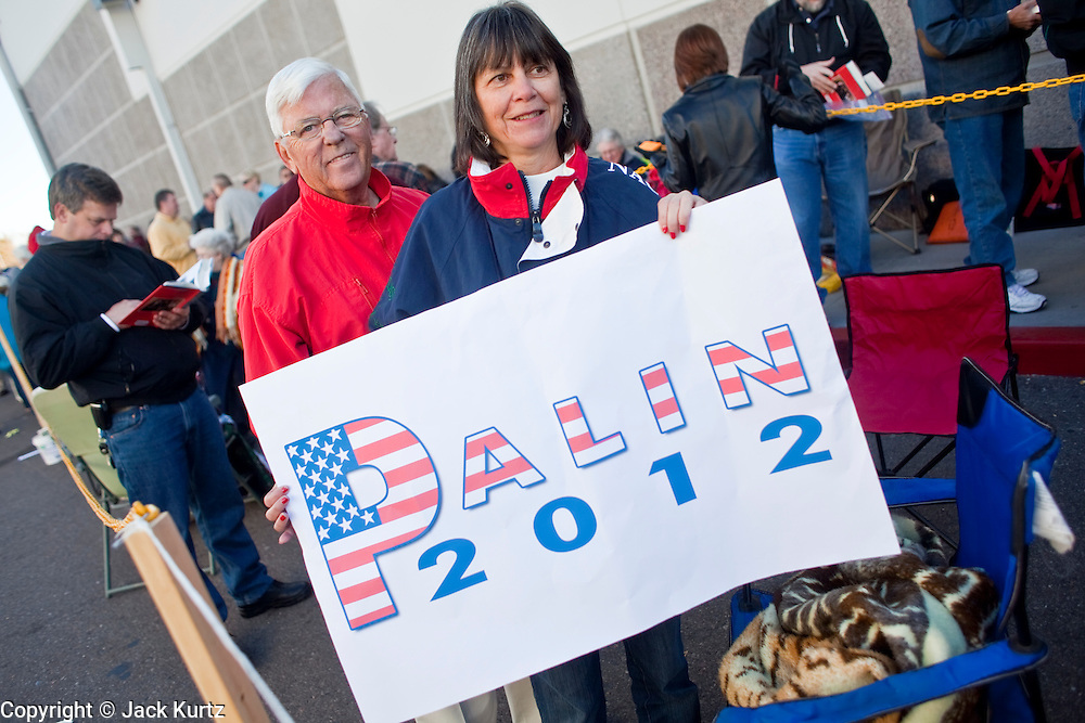 """Dec. 1, 2009 -- TEMPE, AZ: PHYLLIS TKACH, from Scottsdale, AZ, brought a sign endorsing Sarah Palin for President in 2012 to the Palin book signing in Tempe, AZ. Former Alaska Governor Sarah Palin signed copies of her book, """"Going Rogue"""" at a Costco in Tempe, AZ, Tuesday. More than one thousand people showed up for the signing. About 150 of them spent the night at the store. Palin did not make any comments or speak to the address during her appearance in Tempe.  Photo by Jack Kurtz"""