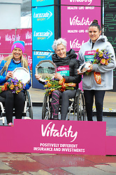 March 10, 2019 - London, United Kingdom - Margaret Van Den Broek, Eden Rainbow Cooper and Mel Nicholls, are seen posing with their awards after running The Vitality Big Half, which has returned for a festival of running and culture to the heart of London in a celebration of the rich and wonderful diversity of the capital city and Finishing it at Cutty Sark. (Credit Image: © Terry Scott/SOPA Images via ZUMA Wire)