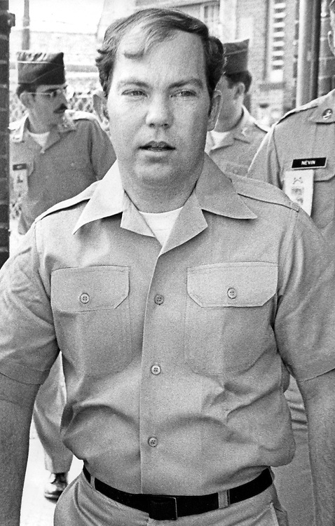 """Convicted of the murder of 102 VietNamese civilians -the My Lai Massacre - former U.S. Army Lieutenant William Calley is escorted from the Fort Benning, Georgia confinement facility to a federal appeals court in nearby Columbus, Ga. At a later date, Calley's original sentence of life in prison was turned into an order of house arrest, but after three years, President Richard Nixon reduced his sentence with a presidential pardon -- Determine pricing and license this image, simply by clicking """"Add To Cart"""" below --"""