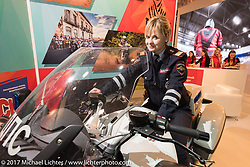 Female motorcop was on hand to answer questions in a City of Moscow display at the Custom and Tuning Show, the custom bike show portion of the big Motor Spring bike show in Moscow, Russia. Sunday April 23, 2017. Photography ©2017 Michael Lichter.