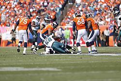 Denver Broncos quarterback Peyton Manning #18 is sacked by Philadelphia Eagles defensive end Cedric Thornton #72 and outside linebacker Trent Cole #58 during the NFL game between the Philadelphia Eagles and the Denver Broncos on Sunday, September 29th 2013 in Denver, Colorado. The Broncos won 52-20. (Photo by Brian Garfinkel)