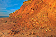 Red sandstone cliffs along Aspy Bay. Cape Breton Island.<br />Aspy Bay<br />Nova Scotia<br />Canada