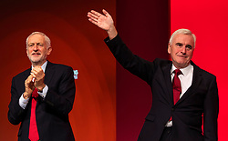 © Licensed to London News Pictures. 24/09/2018. Liverpool, UK. Labour Party Leader Jeremy Corbyn MP (L) and Shadow Chancellor John McDonnell MP (R) celebrate after the Shadow Chancellor's speech to the Labour Party Conference 2018. Photo credit: Rob Pinney/LNP