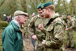 The Duke of Sussex talks to 96 year old former World War 2 Marine Knocker White during a visit to 42 Commando Royal Marines at their base in Bickleigh.