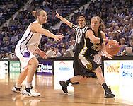 Missouri guard Blair Hardiek (23) looks to make a pass against pressure from Kansas State's Kimberly Dietz (13), during Missouri's 66-65 overtime win over K-State at Bramlage Coliseum in Manhattan, Kansas, February 1, 2006.