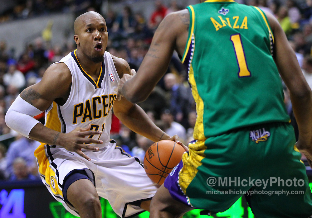 Feb. 21, 2012; Indianapolis, IN, USA; Indiana Pacers power forward David West (21) dribbles the ball against New Orleans Hornets small forward Trevor Ariza (1) at Bankers Life Fieldhouse. Indiana defeated New Orleans 117-108. Mandatory credit: Michael Hickey-US PRESSWIRE