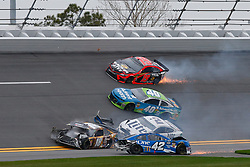 February 10, 2019 - Daytona, FL, U.S. - DAYTONA, FL - FEBRUARY 10: Kyle Busch, driver of the #18 M&MÃ•s Chocolate Bar Toyota, Kyle Larson, driver of the #42 Credit One Bank Chevy, Brad Keselowski, driver of the #2 Miller Lite Ford, Jamie McMurray, driver of the #40 AdventHealth Chevy, and Martin Truex Jr., driver of the #19 Bass Pro Shops/Tracker ATVs Toyota, are all involved in a crash during the Advance Auto Parts Clash on February 10, 2019 at Daytona International Speedway in Daytona Beach, FL. (Photo by David Rosenblum/Icon Sportswire) (Credit Image: © David Rosenblum/Icon SMI via ZUMA Press)