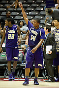 Carl Blair (24) of Prairie View A&M celebrates after defeating Jackson State in the SWAC semi-finals at the Curtis Culwell Center in Garland on Friday, March 15, 2013. (Cooper Neill/The Dallas Morning News)