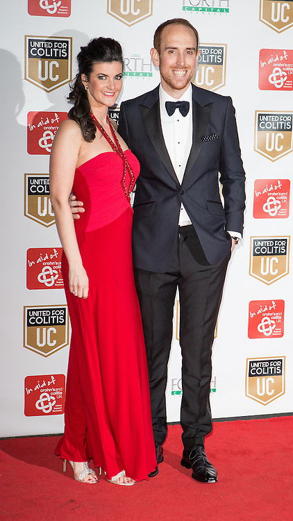© Licensed to London News Pictures . 27/03/2014 . Manchester , UK . Nicky Butt (r) arrives at a gala dinner at Manchester United Football Club in support of United for Colitis , in aid of Crohn's And Colitis UK . Photo credit : LNP