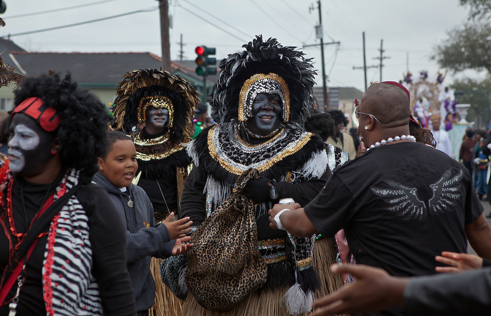 Man wearing Zulu face paint at the Zulu Parade on Fat Tuesday in New Orleans.