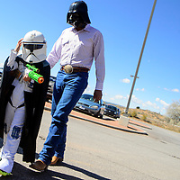 102613  Adron Gardner/Independent<br /> <br /> Five-year-old Cade Curley, left,  adjusts his clone trooper helmet while Leandrew Lynch dons the Darth Vader mask as they walk to Zoo Boo at the Navajo Nation Zoo in Window Rock Saturday.