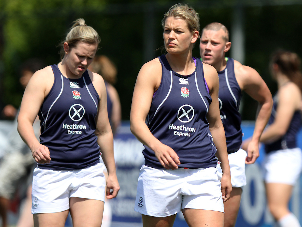 Marlie Packer, Abi Chamberlain and Heather Fisher during a warm up. IRB WSWS Amsterdam 7s Day 1 at National Rugby Centre, Amsterdam, Netherlands on 16th May 2014