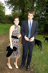 OTIS FERRY and his girlfriend LAURA HUW-WILLIAMS at the wedding of Lucy Ferry to Robin Birley held at Ormsby Lodge, Ham Gate Avenue, Ham, Surrey on 26th October 2006.<br /><br />NON EXCLUSIVE - WORLD RIGHTS