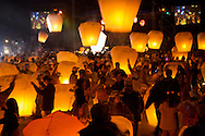 """In Pingsi, Taiwan, thousands of people fly """"Sky Lanterns"""" on the 15th day of the new lunar year.  With the launcher's hopes and dreams written on the lantern, it is said that the higher the lantern goes, the closer it will come to God, and the better the chances that the wish will come true."""