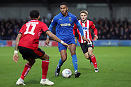 AFC Wimbledon defender Terell Thomas (6) dribbling and taking on Lincoln City midfielder Bruno Andrade (11) during the EFL Sky Bet League 1 match between AFC Wimbledon and Lincoln City at the Cherry Red Records Stadium, Kingston, England on 2 November 2019.