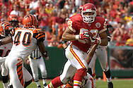 October 14, 2007 - Kansas City, MO..Tight end Tony Gonzalez #88 of the Kansas City Chiefs brings the ball up field against pressure from safety Madieu Williams #40 of the Cincinnati Bengals, during a NFL football game at Arrowhead Stadium in Kansas City, Missouri on October 14, 2007...FBN:  The Chiefs defeated the Bengals 27-20.  .Photo by Peter G. Aiken/Cal Sport Media