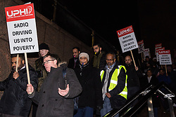 London, UK. 4th February, 2019. James Farrar joins hundreds of Uber minicab drivers marching to protest outside City Hall after having left their vehicles blocking London Bridge as part of a protest organised by the United Private Hire Drivers (UPHD) branch of the Independent Workers Union of Great Britain's (IWGB)  following the introduction in December of congestion charges for minicabs.