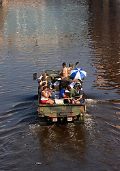 31st August, 2005. New Orleans Louisiana. <br /> Hurricane Katrina.  Storm refugees are trucked to 'Hell on earth,' The Superdome in New Orleans, Louisiana where over 20,000 refugees from hurricane Katrina are crammed into hellish conditions. <br /> Photo Credit: Charlie Varley/varleypix.com