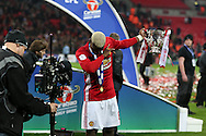 Paul Pogba of Manchester Utd does the 'dab' as he celebrates with the trophy at the end of the game  EFL Cup Final 2017, Manchester Utd v Southampton at Wembley Stadium in London on Sunday 26th February 2017. pic by Andrew Orchard, Andrew Orchard sports photography.