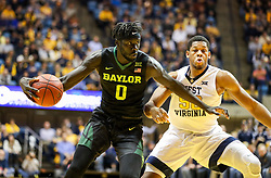 Jan 9, 2018; Morgantown, WV, USA; Baylor Bears forward Jo Lual-Acuil Jr. (0) drives the lane past West Virginia Mountaineers forward Sagaba Konate (50) during the first half at WVU Coliseum. Mandatory Credit: Ben Queen-USA TODAY Sports