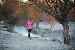 © Licensed to London News Pictures. 16/12/2017. London, UK. A runner makes her way through a frost and mist covered landscape in Richmond Park. Parts of the UK are experiencing freezing temperatures today with snow expected in parts. London, UK. Photo credit: Ben Cawthra/LNP