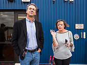 12 SEPTEMBER 2019 - DES MOINES, IOWA: Governor STEVE BULLOCK (D-MT), left, talks to JEANNINE LAUGHLIN, Area Administrator for New Horizons Academy after a Caucus for Kids Facebook Live broadcast sponsored by the Children's Policy Coalition at the school. Gov. Bullock is vying to be the Democratic party's nominee in 2020. He is campaigning in Iowa this week he didn't qualify for the September 12 debate. Iowa traditionally hosts the the first election event of the presidential selection cycle. The Iowa Caucuses will be on Feb. 3, 2020.                     PHOTO BY JACK KURTZ