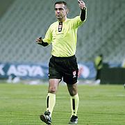 Referee's Kuddusi MUFTUOGLU during their Play Off First leg match at Ataturk olympic Stadium in Istanbul Turkey on Monday, 17 May 2010. Photo by TURKPIX