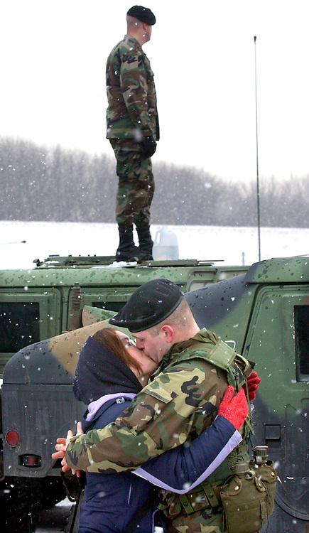 2/12/03  Photo by Mara Lavitt-Goodbye 3<br />ML0052E #9082<br />Brainerd Armory, Hartford: Susie Kudla of Storrs and Spc. David Harrell of Willington embrace before Harrell leaves for Ft. Drum with the convoy.