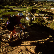 Heather Goodrich drops into the final leg on the Ledges Trail in Eagle, Colorado.