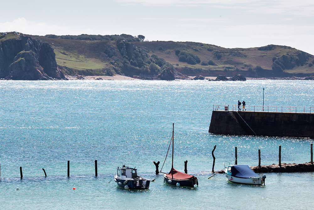 Boats moored up near the pier at St Brelade's Bay, a popular tourist destination on the south coast of Jersey, Channel Islands