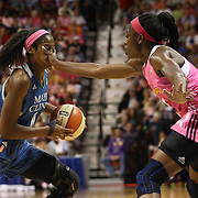 Devereaux Peters, Minnesota Lynx, receives some in your face defense from Chiney Ogwumike, Connecticut Sun, during the Connecticut Sun Vs Minnesota Lynx, WNBA regular season game at Mohegan Sun Arena, Uncasville, Connecticut, USA. 27th July 2014. Photo Tim Clayton