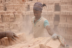 February 5, 2018 - Dhaka, Bangladesh - Seasonal brick field laborer works on dust as they arrange bricks on a cart at a brick factory in the outskirts of Dhaka. (Credit Image: © Md. Mehedi Hasan via ZUMA Wire)