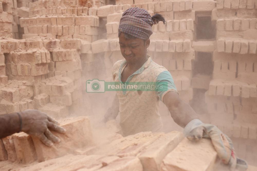 February 5, 2018 - Dhaka, Bangladesh - Seasonal brick field laborer works on dust as they arrange bricks on a cart at a brick factory in the outskirts of Dhaka. (Credit Image: © Md. Mehedi Hasan via ZUMA Wire)