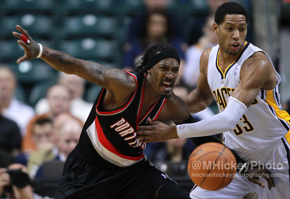 March 13, 2012; Indianapolis, IN, USA; Portland Trail Blazers small forward Gerald Wallace (3) has the ball stripped by Indiana Pacers small forward Danny Granger (33) at Bankers Life Fieldhouse. Mandatory credit: Michael Hickey-US PRESSWIRE