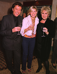 Left to right, LIONEL BLAIR his niece actress DEBORAH SHERIDAN-TAYLOR and her mother MISS JOYCE BLAIR, at a party in London on 27th January 1999.MNM 24