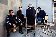 Men play cards in the Kond District of Yerevan, Armenia. April 23, 2016.