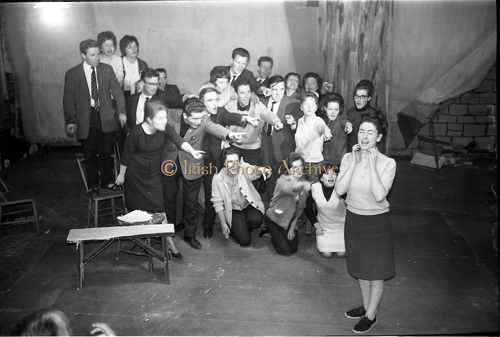 """14/09/1964<br /> 09/14/1964<br /> 14 September 1964<br /> Rehearsal for """"An Triail"""" by Mired Ní Ghrada, which Gael-Linn presented at Damer Hall from the 22/09/1964. It was the only Irish Language contribution to the Dublin Theatre Festival that year. Play was produced by Tomás Mac Anna. Image shows a scene from the play."""