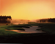 The sun rises over a foggy golf course in the south