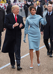 President Donald Trump and First Lady Melania Trump walk in their inaugural parade after being sworn-in as the 45th President in Washington, D.C. on January 20, 2017. Photo by Kevin Dietsch/UPI