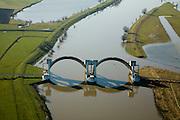 Nederland, Gelderland, Driel, 11-02-2008;<br /> Stuw in de Neder-Rijn ten Westen van Arnhem, de vizierschuif van de stuw is geopend in verband met het hoogwater.  De stuw dient om waterpeil van Neder-Rijn en IJssel te reguleren: als de Rijn weinig wateraanvoer heeft wordt de stuw gesloten om er voor te zorgen dat de verder stroomopwaarts gelegen IJssel (ten Oosten van Arnhem) voldoende water krijgt. Het stuweiland is afgegraven en kan nu gedeeltelijke overstromen, waardoor snellere waterafvoer mogelijk is.<br /> Rechts de schutsluis die wordt gebruik als de stuw gesloten is.<br /> Flood-control dam or weir in the Lower-Rhine to control the waterlevels. The weir is open, allowing the river to flow in the direction of the sea). At low levels the weir closes to maintain sifficient high water level in the river IJssel (upstream).luchtfoto (toeslag); aerial photo (additional fee required); .foto Siebe Swart / photo Siebe Swart