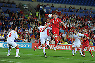 Steve Morison of Wales heads the ball. Euro 2012 Qualifying match, Wales v Montenegro at the Cardiff City Stadium in Cardiff  on Friday 2nd Sept 2011. Pic By  Andrew Orchard, Andrew Orchard sports photography,