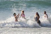 Israel, Tel Aviv, splashing in the sea