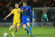 Joe Bunney makes a challenge during the EFL Sky Bet League 1 match between Rochdale and Oxford United at Spotland, Rochdale, England on 12 March 2019.
