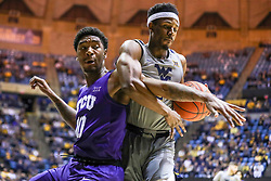 Jan 14, 2020; Morgantown, West Virginia, USA; West Virginia Mountaineers guard Brandon Knapper (2) grabs a rebound over TCU Horned Frogs forward Diante Smith (10) during the first half at WVU Coliseum. Mandatory Credit: Ben Queen-USA TODAY Sports