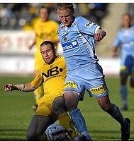 Fotball<br /> 2 juni 2008<br /> Tippeligaen<br /> Bodø/Glimt - Lillestrøm<br /> John Midttun Lie , Lillestrøm i takling med Mounir Hamoud , Bodø/Glimt<br /> Foto: Reidar Talset , Digitalsport