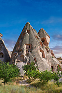 Pictures & images of the cave city houses in the rock formations & fairy chimney of Uchisar, near Goreme, Cappadocia, Nevsehir, Turkey .<br /> <br /> If you prefer to buy from our ALAMY PHOTO LIBRARY  Collection visit : https://www.alamy.com/portfolio/paul-williams-funkystock/cappadociaturkey.html (TIP refine search - type which part of Cappadocia into the LOWER search box)<br /> <br /> Visit our TURKEY PHOTO COLLECTIONS for more photos to download or buy as wall art prints https://funkystock.photoshelter.com/gallery-collection/3f-Pictures-of-Turkey-Turkey-Photos-Images-Fotos/C0000U.hJWkZxAbg