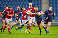 Jaco van der Walt (#10) of Edinburgh Rugby looks to fend off the tackle of Paul Abadie (#9 of SU Agen Rugby during the European Rugby Challenge Cup match between Edinburgh Rugby and SU Agen at BT Murrayfield, Edinburgh, Scotland on 18 January 2020.